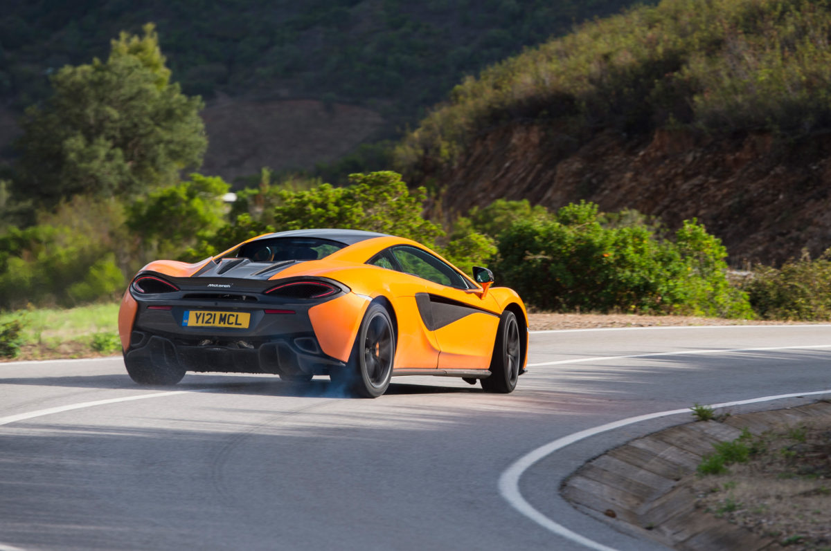 2016-mclaren-570s-rear-three-quarter-in-motion-01